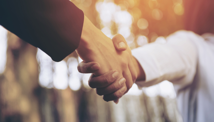 Shaking hands to secure a deal
