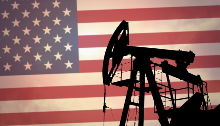 US flag and oil derrick